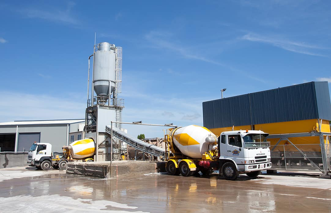 HB Concrete - batch plants in Darwin and Palmerston. Employees and drivers of concrete trucks - trucks loading